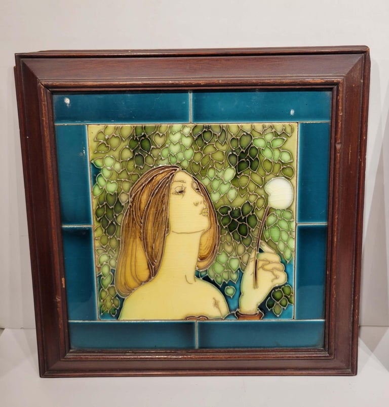 This pair of English ceramic tiles each depicting a beautiful maiden blowing on what it seems to be dandelions are framed in their original frames and date to the end of 19th century. We have not opened the back to see if there are any marking on
