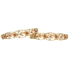 Pair of Art Nouveau Gold, Pearl and Ruby Openwork Floral Motif Bracelets