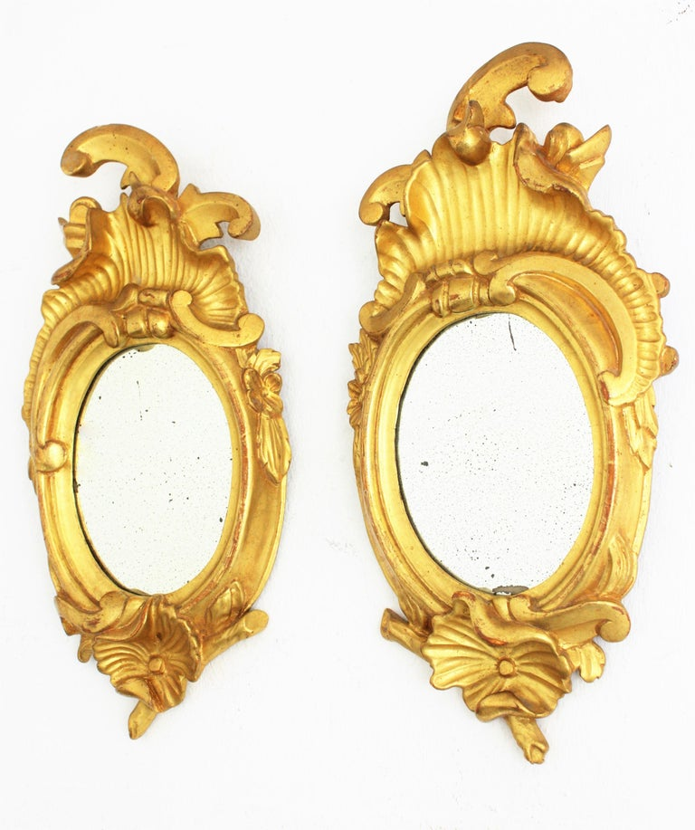 Spanish Pair of Art Nouveau Left and Right Gold Leaf Giltwood Mini Sized Mirrors For Sale