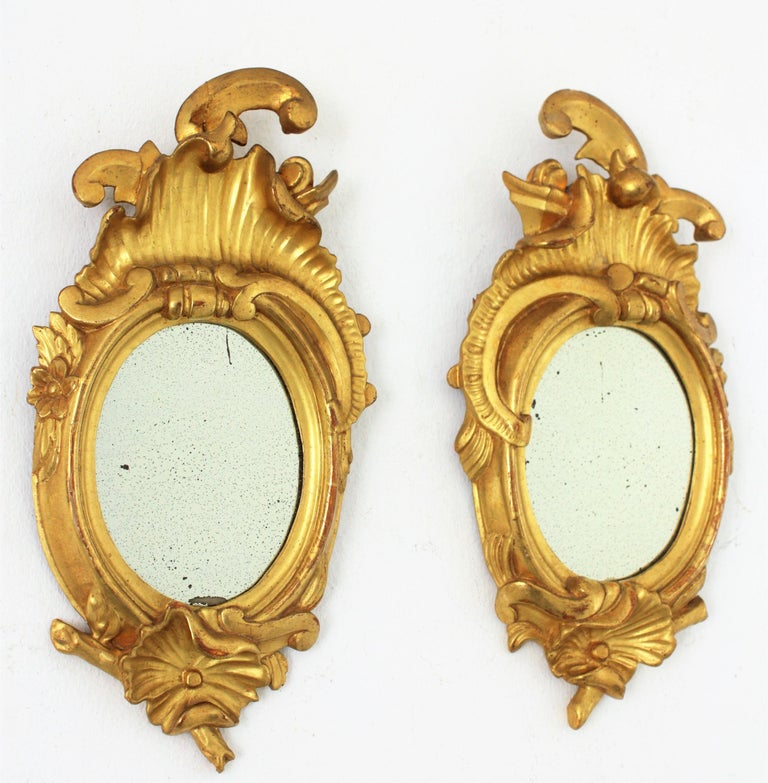 Hand-Carved Pair of Art Nouveau Left and Right Gold Leaf Giltwood Mini Sized Mirrors For Sale