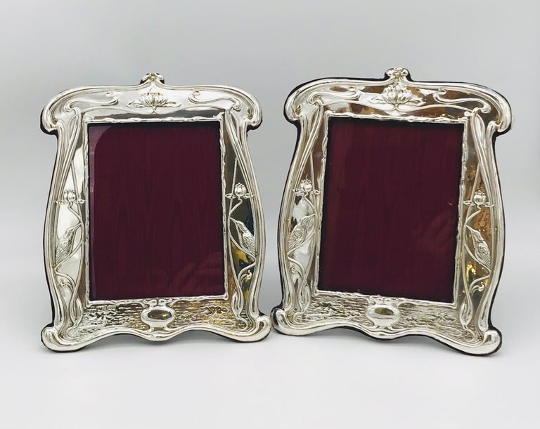 Pair of Art Nouveau antique English silver photograph frames of large, Classic form, and with recently refurbished red velvet and satin. Made by W. Neale & Sons and hallmarked in Chester and Birmingham, 1907-1908.