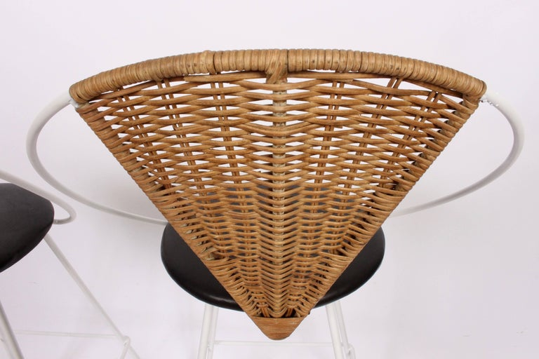 Mid-20th Century Pair of Arthur Umanoff for Shaver Howard Iron, Rattan & Black Leather Bar Stools For Sale