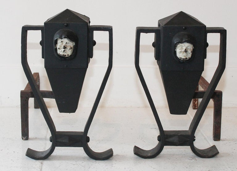 Perfectly patinated early 20th century Arts & Crafts handwrought andirons feature white-painted cast iron monks.