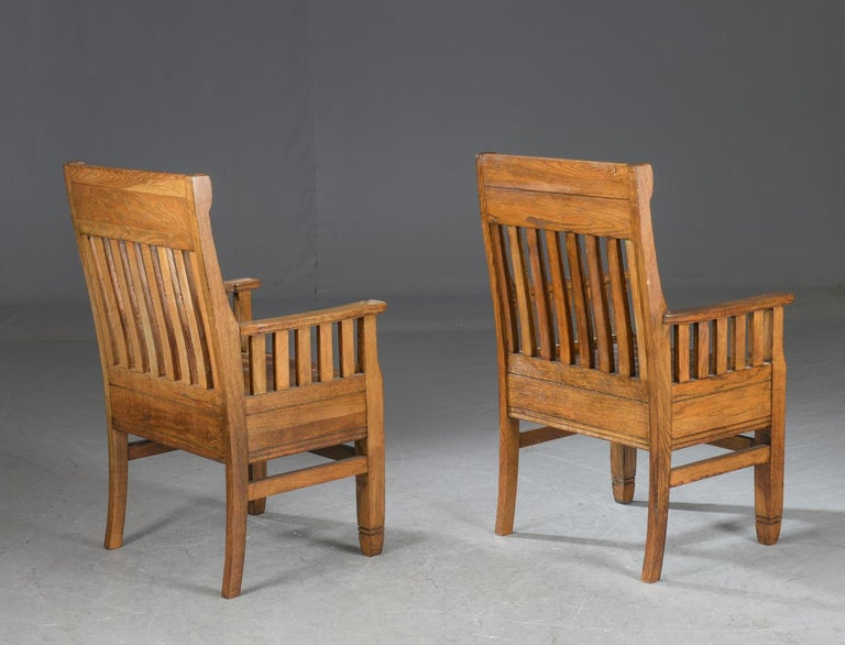 Pair of Arts & Crafts smoked oak armchairs. Hence the rich color. H. 105 cm. B. 63 cm. SH. 48 cm. Traces of wear. Danish, early 20th century.