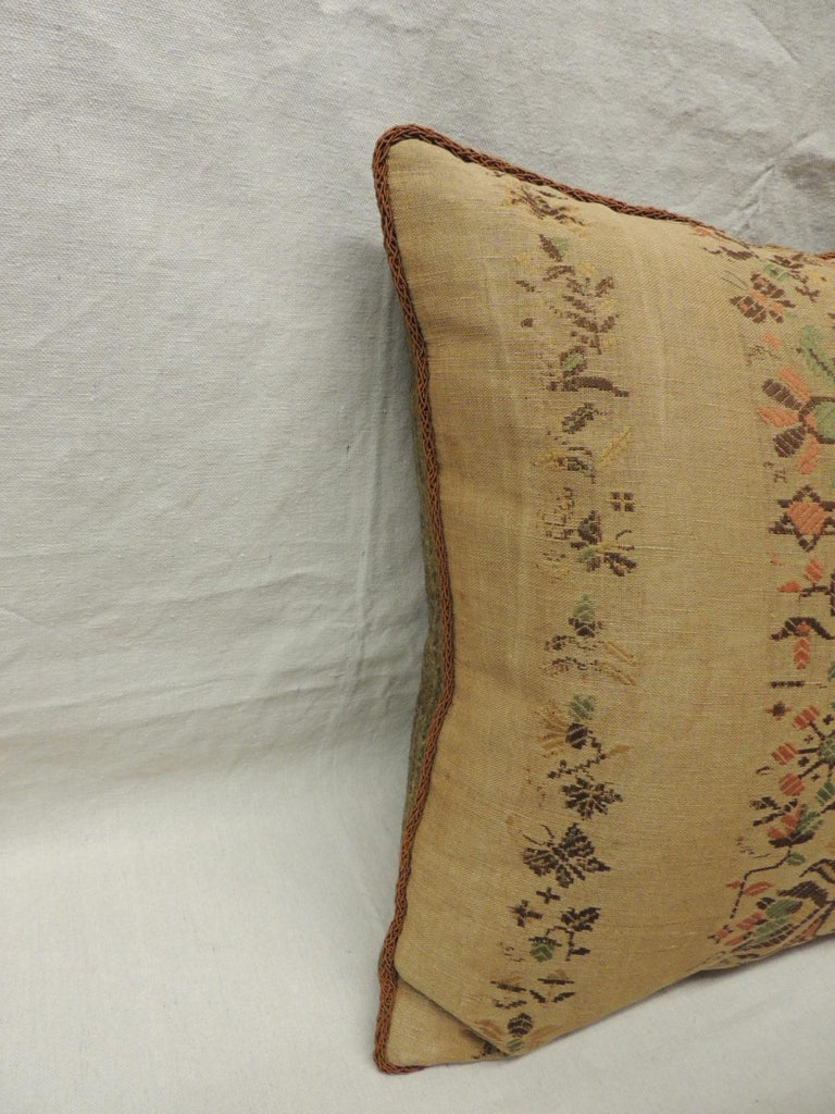 Pair of Arts & Crafts woven linen green and orange floral decorative pillows.