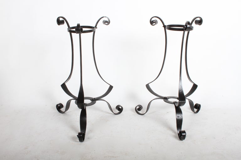 Nice pair of Arts & Crafts period hand forged scroll design wrought iron planters or plant stands. These have been sandblasted, dipped in rust primer, and painted satin black. Planters hold 8