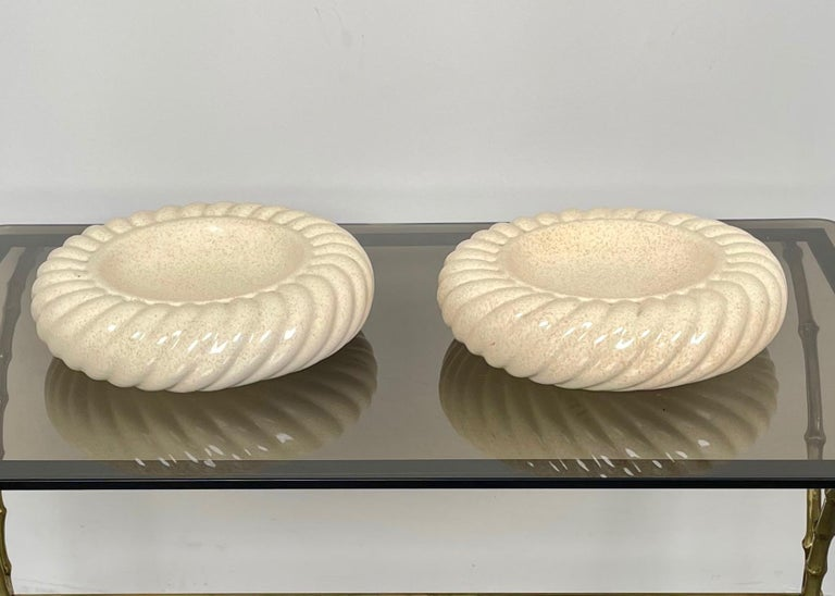 Pair of ashtrays vide-poche in beige ceramic by Tommaso Barbi for B Ceramiche, Italy 1970s.  Tommaso Barbi's original stamp is still visible on the bottom of both items, as shown in photos.