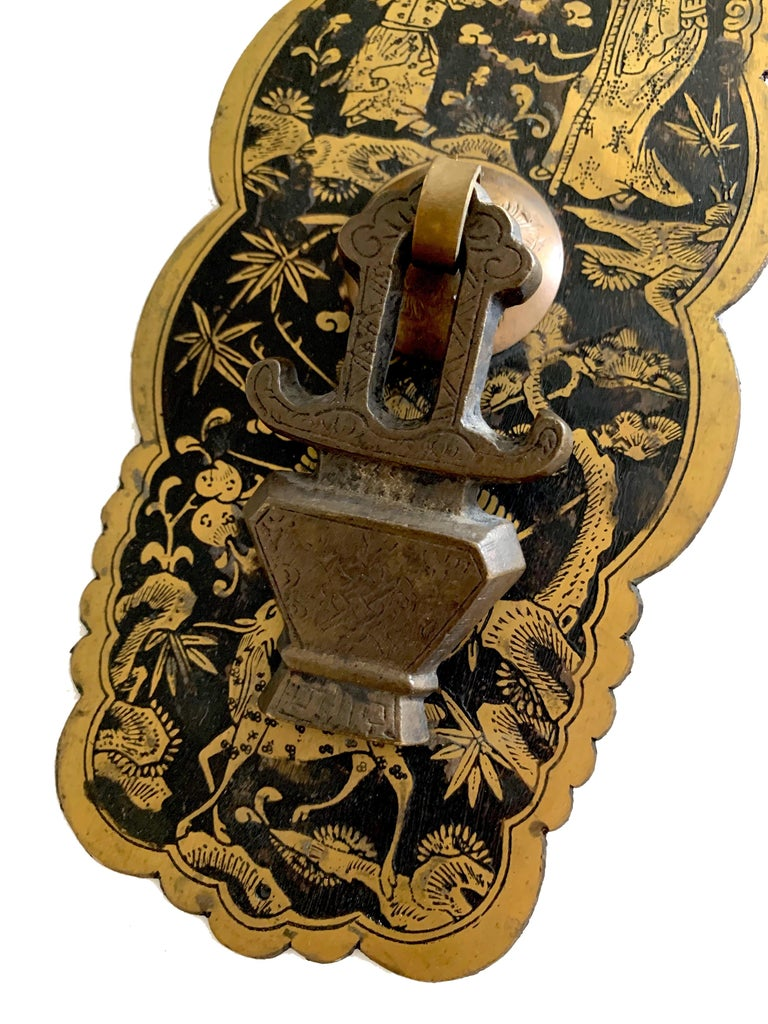 """Pair of large mid-century chinoiserie metal door hardware. Acid etched brass backplate with all over chinoiserie design. Pagoda style center knob is 3"""" tall x 1.75"""" wide. Overall unpolished patina. Top and bottom center holes, installation hardware"""