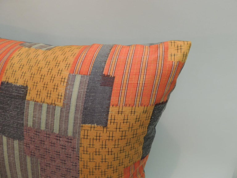 Pair of Asian Patchwork style printed silk pillows with green silk backings.