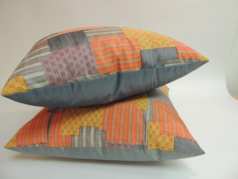 Japanese Pair of Asian Patchwork Style Printed Silk Pillows with Green Silk Backings For Sale