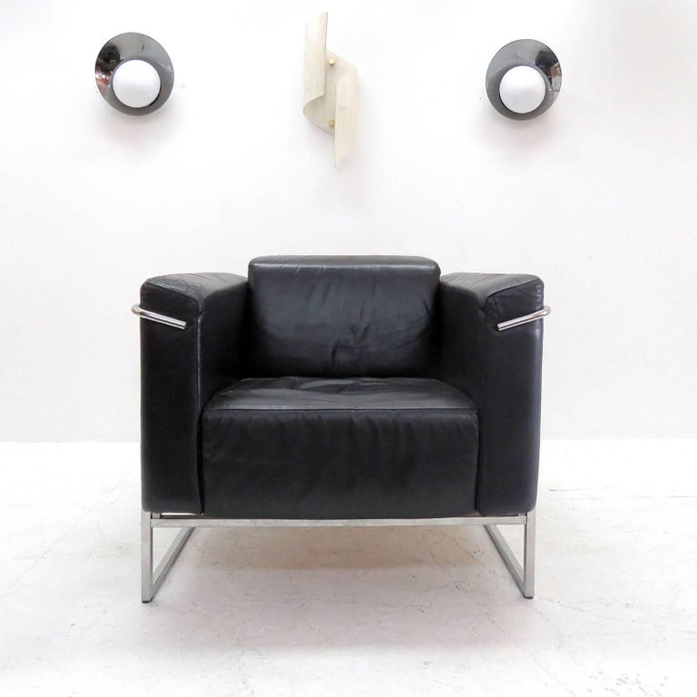 Stunning pair of 'Classio, model 8283' chrome and black leather chairs by Asko, Finland, designed in 1982, cubic design similar to LeCorbusier's LC2 lounge chairs, marked.