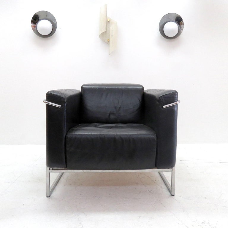 Stunning pair of 'Classio, model 8283' chrome and black leather chairs by Asko, Finland, designed in 1982, cubic design similar to Le Corbusier's LC2 lounge chairs, marked.