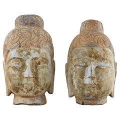 Pair of Associated Chinese Style Carved Stone Buddha Head Busts