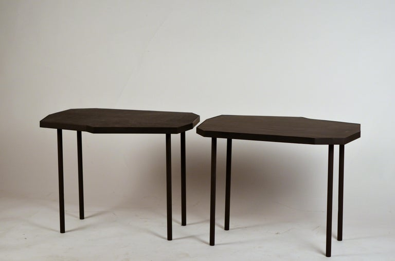 Pair of asymmetrical 'Décagone' black leather side tables by Design Frères.  Great next to a pair of armchairs.
