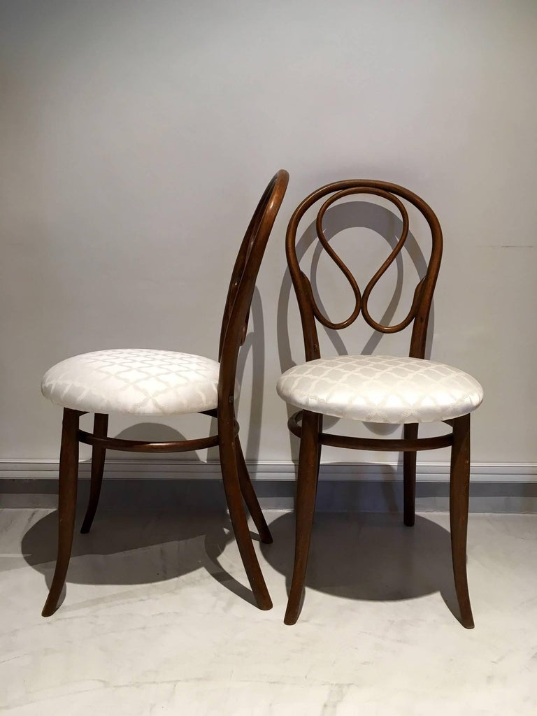 Bentwood chairs with new silk-blend seat upholstery. Chairs designed by August Thonet, the son of original bentwood furniture designer Michael Thonet. August took over his father's business in 1869.