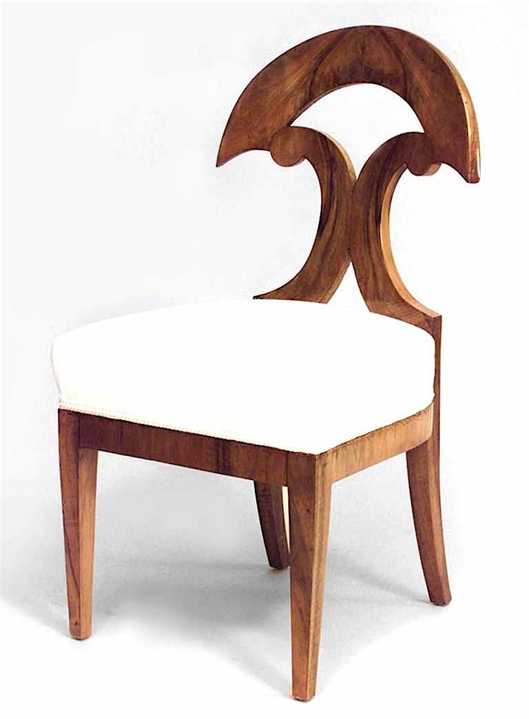 Pair of Austrian Biedermeier walnut veneer side chairs with half round and double scroll design back, circa 1830.