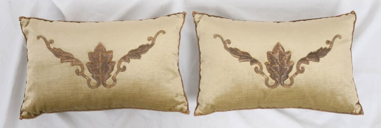 Antique European raised gold metallic embroidery on pale chartreuse velvet, hand-trimmed with gold metallic cording which is knotted at the corners. Down-filled. Designed by Rebecca Vizard for V. Biz Design. Available for individual purchase at