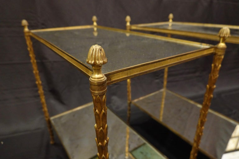 Brass Pair of Bagues Gilt-Bronze Two-Tiered Side Tables with Eglomise Glass Tops For Sale