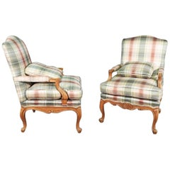 Pair of Baker Furniture French Louis XV Style Carved Walnut Fauteuils circa 1970