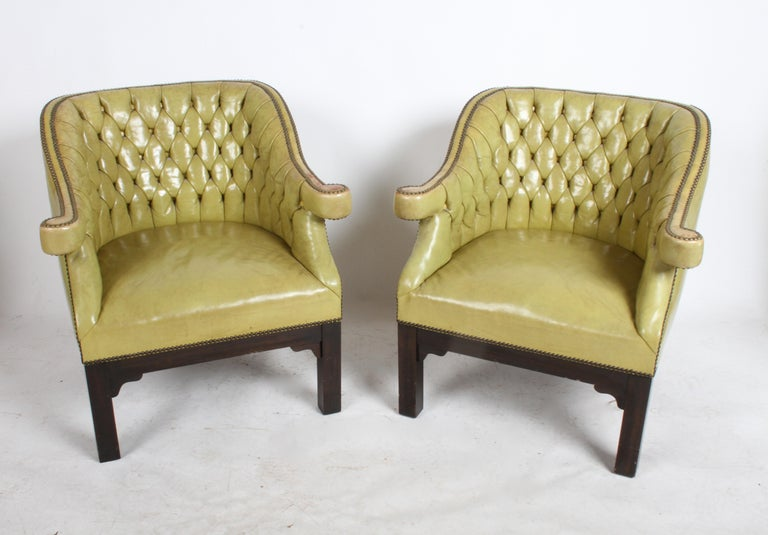 Pair of vintage Chartreuse leather Baker Furniture Company tufted lounge or club chairs. Original leather having brass studs and tufted backs, on dark mahogany Asian inspired frames. Possibly from the Far East collection by Michael Taylor circa