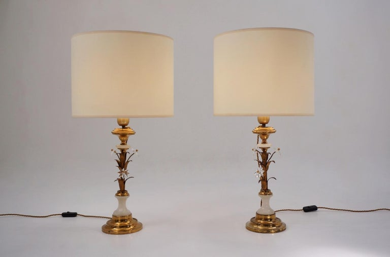 Pair of Banci Firenze Florentine tole gold gilt table lamps, crystal flowers on alabaster columns, circa 1950s, Italian. These table lamps have been gently cleaned while respecting the antique patina. Both are newly rewired, earthed, fully working