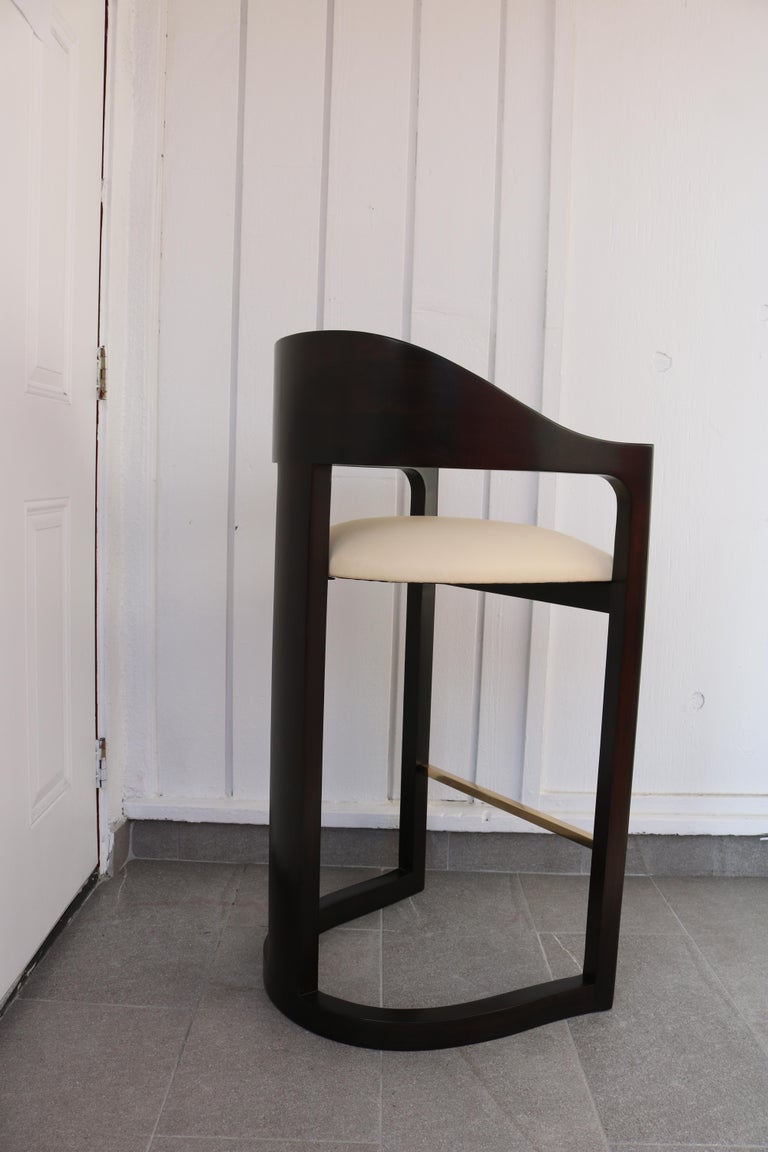 Mid-Century Modern Pair of Bar Stools with Brass Foot Rests by Karl Springer For Sale