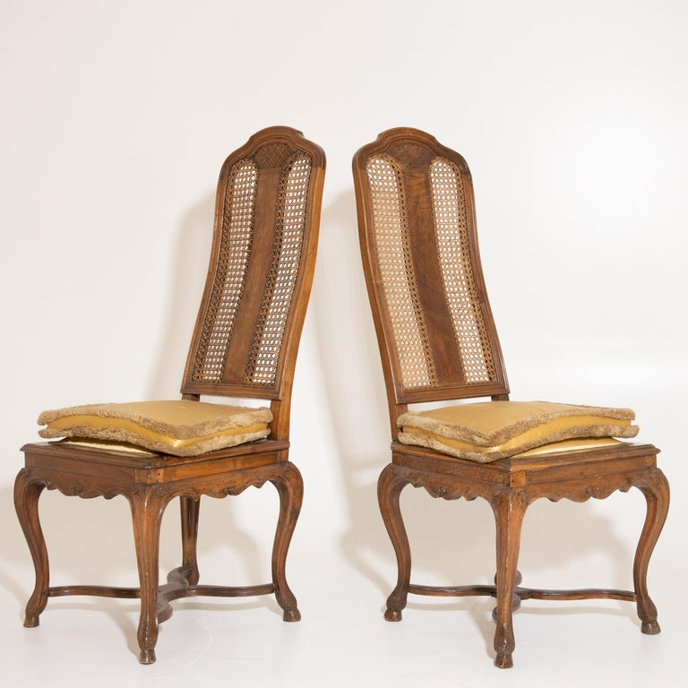 The pair of tongue chairs have a trapezoidal seat. The backrest is mouloured and covered with a jonce weave. Literature: Sotheby's, The Collection of the Margraves and Grand Dukes of Baden, Auction Baden-Baden 5. to 21. October 1995, p. 10, Tf. II,