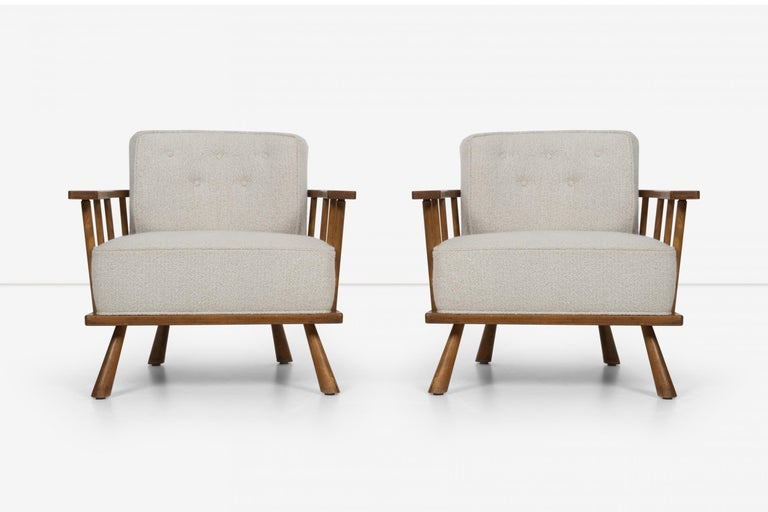 Pair ofbarrel back lounge chairs by Robsjohn-Gibbings, for Widdicomb, Model 1651. Frame made of solid maple spindles which secure boucle reupholstered button tufted tubs, with solid legs.