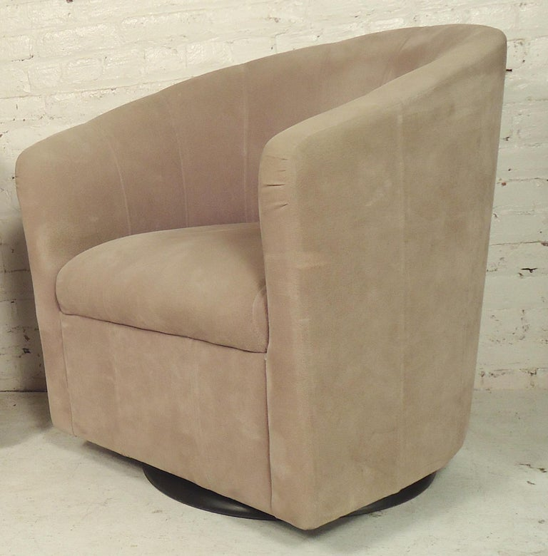 Mid-Century Modern style swivel chairs with barrel backs and suede like fabric.   (Please confirm item location - NY or NJ - with dealer).