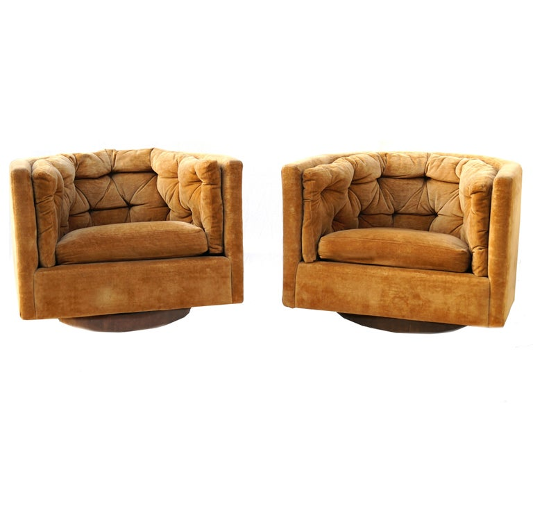 Pair of Barrel swivel chairs in the manner of Milo Baughman.