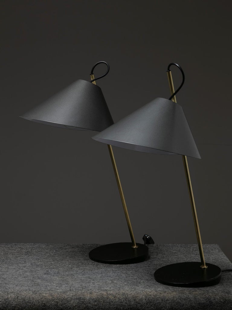 Set of two Base Ghisa table lamps by Luigi Caccia Dominioni for Azucena. Cast iron base supporting a thin brass stem with adjustable metal shade.