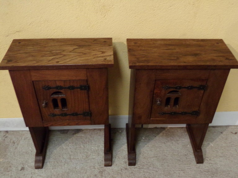 This most unusual pair of oak bedside or end tables  on