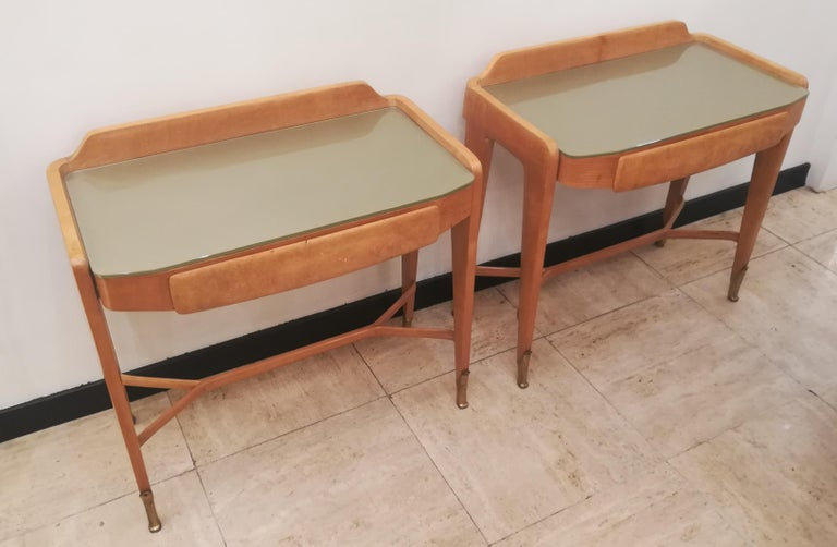 Pair of bedsides or end tables in clear wood, and opalescent glass top with one drawer.