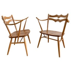 Elegant Pair of Elm and Beech Easy Chairs by Ercol, UK, 1950s. Model 493.