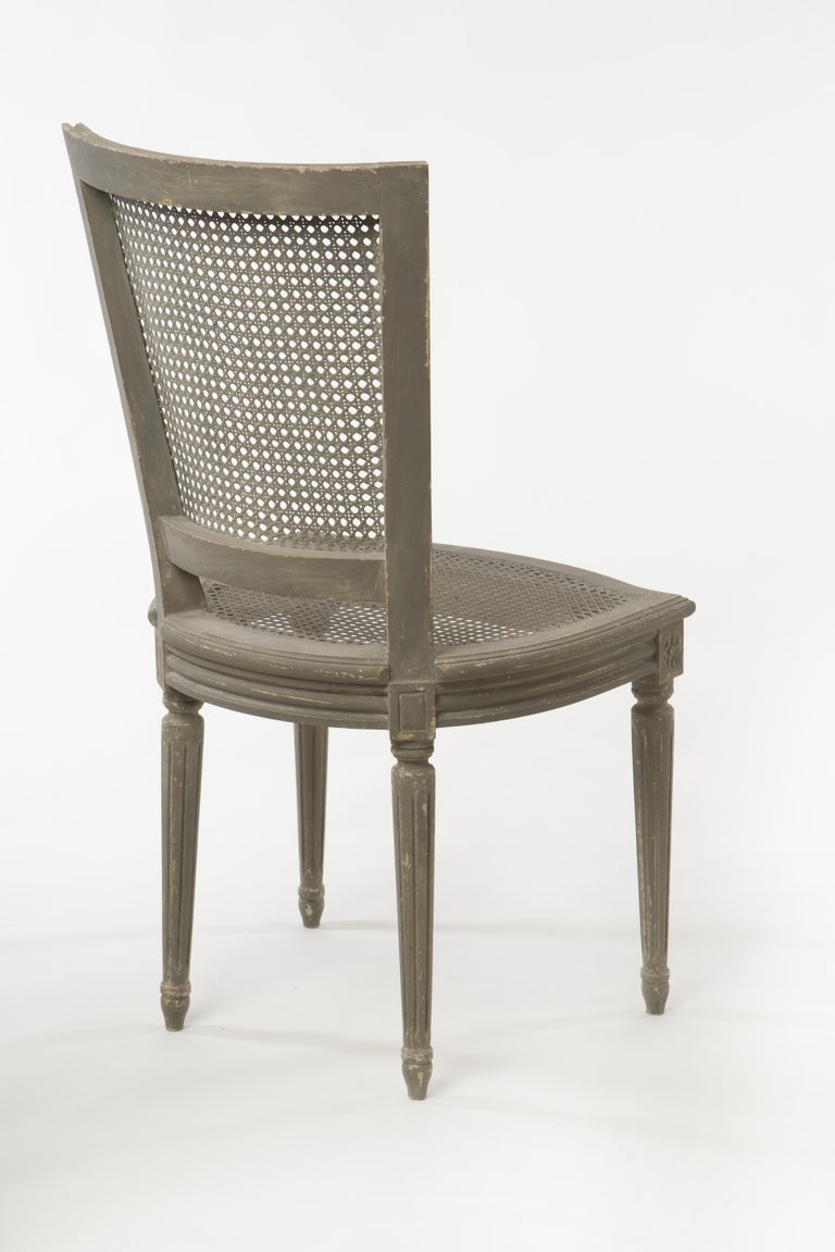 Great pair of Belgian side chairs with basket weaved back and seat. Elegant carvings throughout the chair.