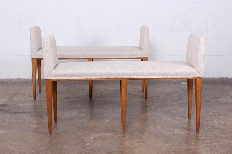 A matching pair of bleached mahogany benches by Edward Wormley for Dunbar.