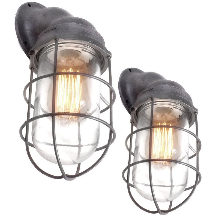 Pair of Benjamin Explosion Proof Caged Sconces For Sale