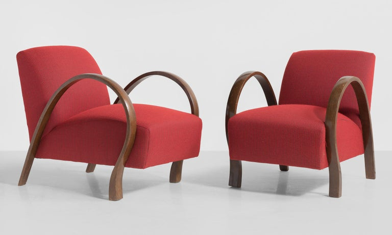 """Pair of modern bentwood armchairs, Italy, circa 1930.  Bentwood arms with unique form. Newly reupholstered in Garnet color Wool Rib fabric by Maharam.   Measures: 22.25"""" W x 31.5"""" D x 28"""" H x 16"""" seat."""