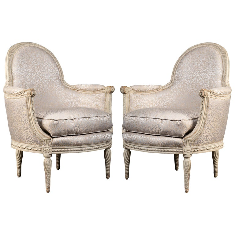 Pair of Bergère Chairs from the Louis XVI Period Stamped, Delanois, 18th Century For Sale