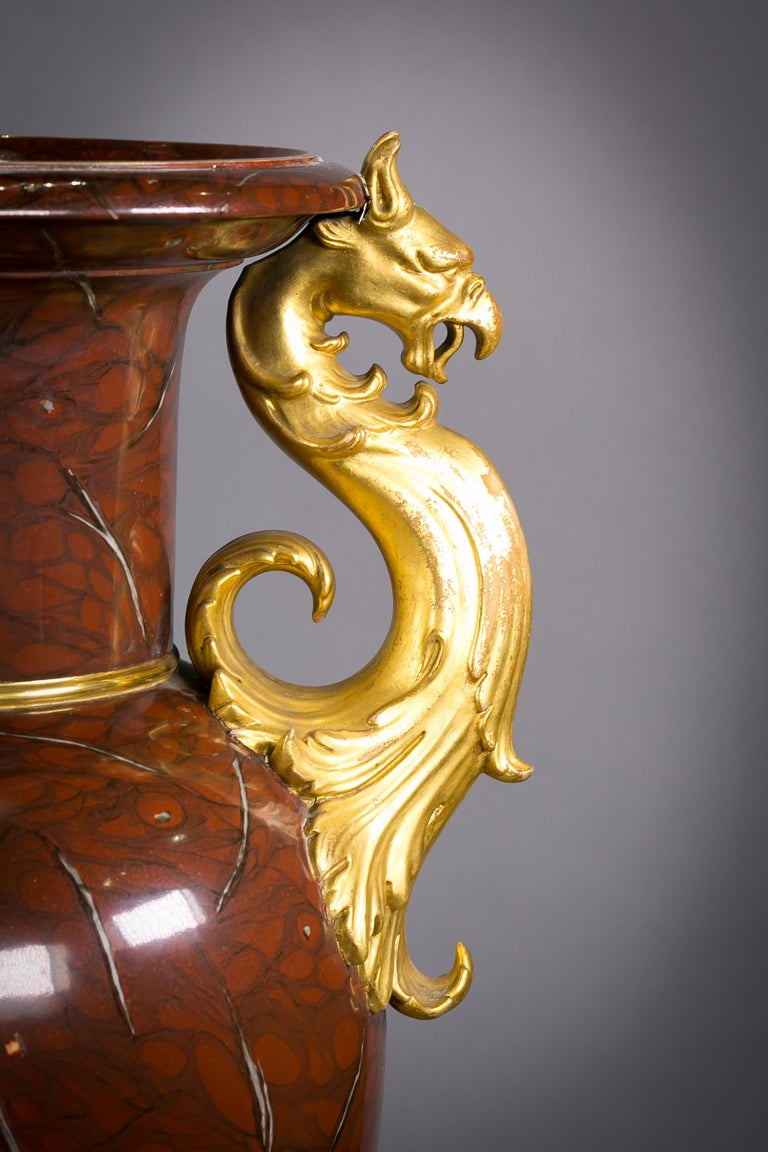 Pair of berlin porcelain faux marble and gilt urns, circa 1825.