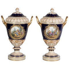Pair of Berlin Porcelain Two-Handled Covered Urns, circa 1870