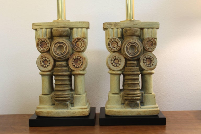 Pair of ceramic lamps by Bernard Rooke. Lamps have been professionally rewired with new black wood bases. Measures: Ceramic portion is 13