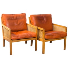 Pair of Bernt Petersen Caned Lounge Chairs with Brown Leather Cushions