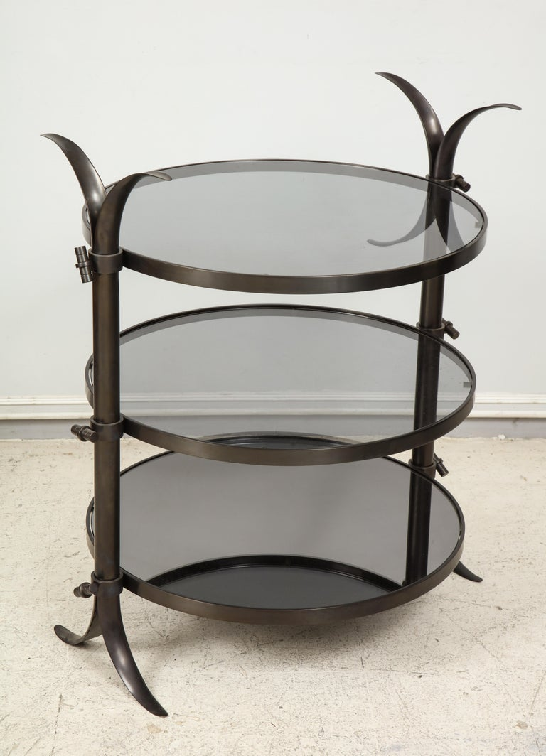 Pair of bespoke bronze tulip tables designed by Amir Khamneipur. Tables can also be sold separately.