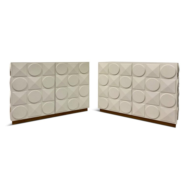 A pair of cabinets  Inspired by the Lego brick  White laminated wood frame  Italian
