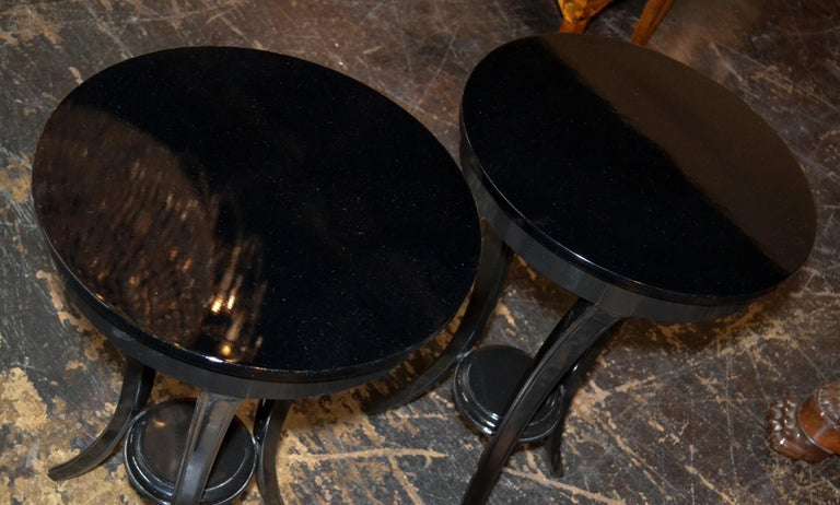 Great pair of Biedermeier style black lacquered 3-leg side tables.