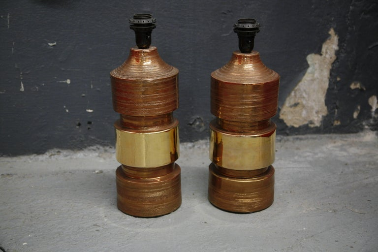 Bitossi lamps Italy 1970 ceramic copper and gold glaze by Bitossi has stickers from Bergboms as they were sold by Bergboms, Sweden. Very strong powerful bodies with such elegant glaze sort of a matte finish except from the gold stripe in the