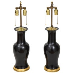 Pair of Black and Gilt Ceramic Vase Lamps