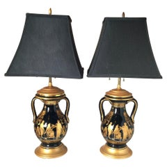 Pair of Black and Gilt Neoclassical Urn Lamps
