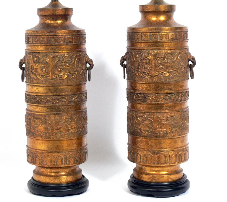 Pair of black and gold Asian lamps, circa 1950s. They have been rewired and are ready to use. The price noted below includes the shades.